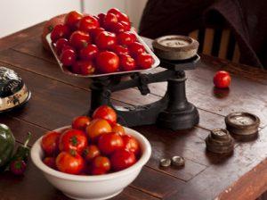 Fresh organic tomatoes on a scale